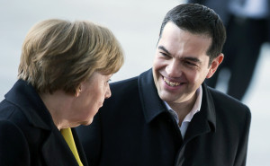 German Chancellor Angela Merkel and Greek Prime Minister Alexis Tsipras review an honour guard during a welcoming ceremony at the Chancellery in Berlin March 23, 2015. Tsipras is meeting Merkel on Monday evening, his first official visit, to discuss Greece's bailout and reform.        REUTERS/Hannibal Hanschke